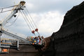 Brown coal huge excavator machine in brown mine Royalty Free Stock Photo