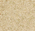 Brown coarse rice texture background Royalty Free Stock Photography