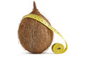 Brown coconut and yellow measuring tape the concept of diet health Stock Photos