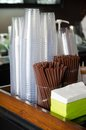 Brown color flexible straws and plastic glasses Stock Photos