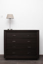 Brown commode with lamp in minimalism interior
