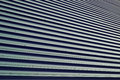 Brown corrugated steel texture modern building wall diminishing perspective Royalty Free Stock Photos