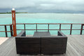 Brown couch at timber pier ocean view Royalty Free Stock Photo