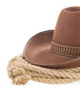 Brown cowboy hat and rope on white Stock Image