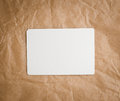 Brown craft paper with a blank tag on white background Royalty Free Stock Images