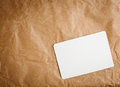 Brown craft paper with a blank tag on white background Royalty Free Stock Image