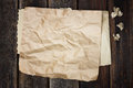 Brown crumpled paper on wood background Royalty Free Stock Images
