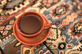 Brown cup of coffee on a tablecloth in an armenian restaurant Royalty Free Stock Photo