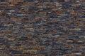 Brown, dark Slate Stone Wall Background. Royalty Free Stock Photo
