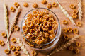 Brown dry pasta in the shape of a flower selective focus Royalty Free Stock Photo