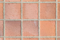 Brown earthenware floor tile seamless background Royalty Free Stock Photo