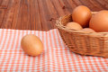 Brown eggs in the basket and on vintage tablecloth Royalty Free Stock Image