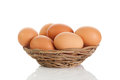 Brown eggs in the basket on white Stock Photo