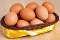 Brown eggs in basket with yellow ribbon Royalty Free Stock Photo