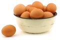 Brown eggs in an enamel bow Royalty Free Stock Photos