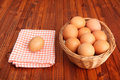 Brown eggs on vintage tablecloth and in the basket Stock Images