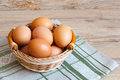 Brown eggs wicker basket Stock Photos