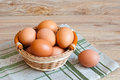 Brown eggs wicker basket Stock Images
