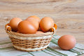Brown eggs wicker basket Royalty Free Stock Image