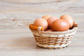 Brown eggs wicker basket Royalty Free Stock Images