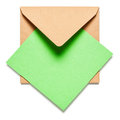 Brown envelope with card square green on white background clipping path included Royalty Free Stock Photography