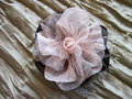 Brown fabric flower brooch on grunge Stock Images