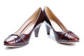 Brown female shoes isolated on a white Royalty Free Stock Photo