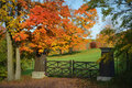Brown fence posts gate fall colors this is a with in front of some beautiful located in lake geneva wi in walworth county Royalty Free Stock Photo
