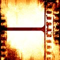 Brown filmstrip grunge with some spots and stains on it Royalty Free Stock Photo