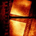 Brown filmstrip grunge with some spots and stains on it Stock Photos