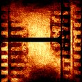 Brown filmstrip grunge with some spots and stains on it Royalty Free Stock Image