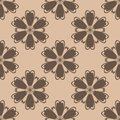 Brown floral ornament on beige background. Seamless pattern Royalty Free Stock Photo