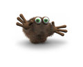 Brown furry creature with green eyes Royalty Free Stock Image
