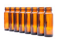 Brown glass bottles selective focus rows of Royalty Free Stock Photos