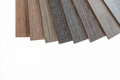 Brown and grey laminate flooring samples on white background Royalty Free Stock Photo