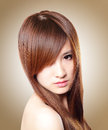 Brown hair beautiful woman healthy long hair isolated brown background asian beauty Stock Photos