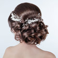 Brown hair styling brunette girl with curly hairstyle with barr barrette bride photo Royalty Free Stock Photography