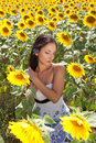 Brown hair and yellow sunflowers Stock Images