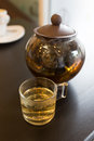 Brown hot tea pot on table with cup Royalty Free Stock Image