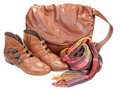 Brown leather bag, scarf and pair feminine boots Royalty Free Stock Images