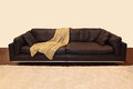 Brown leather couch sofa with wooden parquet floor Royalty Free Stock Photography