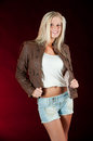 Brown leather jacket and shorts Stock Image