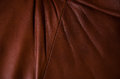 Brown leather texture with folds and seam Royalty Free Stock Photography