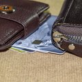 Brown leather wallet with credit and discount Royalty Free Stock Photo