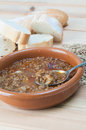 Brown lentil stew in bowl with vegetable and bread Royalty Free Stock Images