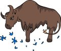 Brown little bison with cornflowers Royalty Free Stock Image
