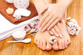 Brown manicure and pedicure on the bamboo beautiful Royalty Free Stock Images
