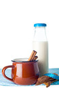 Brown mug, milk, cinnamon and cookies Stock Photo