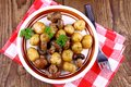 Brown mushrooms fried with round potato top view Stock Image
