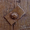 Brown painted old wood background with bolt and square metal detail